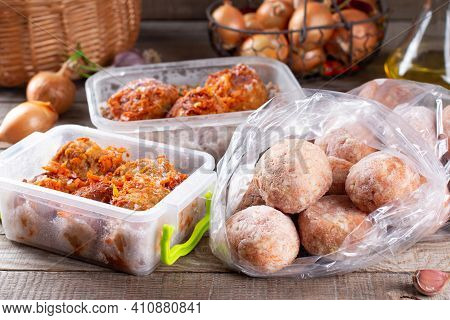 Semi-finished Products, Frozen Meatballs, Meat Patties In Plastic Bag And Container On A Wooden Tabl