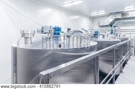 Equipment Dairy Plant, Milk Factory Industry. Stainless Steel Storage And Processing Tanks