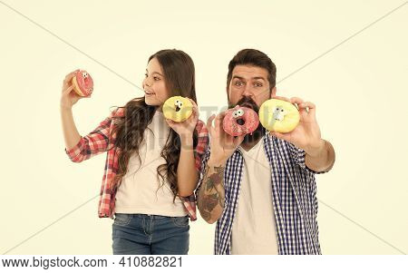Sugar And Dough For Your Life To Be Fun. Happy Family Have Fun With Donuts. Fun Snack. Funny Glazed