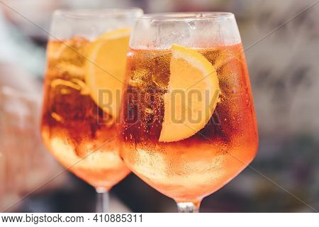 Glass Of Ice Cold Aperol Spritz Cocktail Served In A Wine Glass, Decorated With Slices Of Orange. Ap