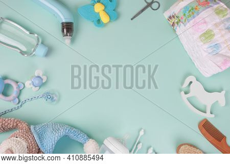 Baby Accessories On Tiffani Background, Flat Lay. Composition With Baby Accessories And Space For Te