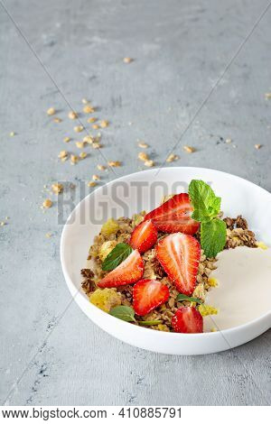 Homemade Crunchy Granola With Nuts, Dried Fruits, Fresh Strawberries, Mint And Yogurt (fermented Bak