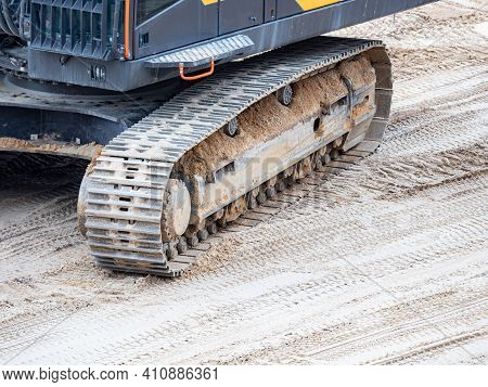 Continuous Tracks On A Heavy Excavator Digger Machine With Track Detail. Open Silica Sand Quarry.