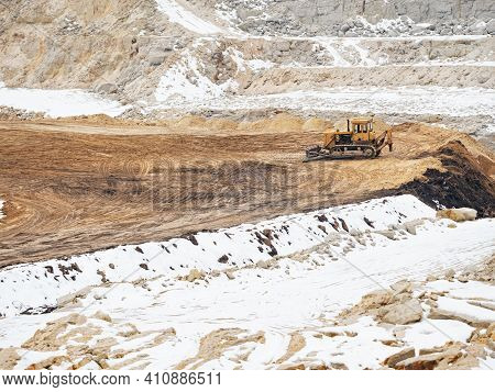 Large Quarry Excavator Of Yellow Color In A Quary.  Digging A Pit In The Ground At A Site With An Ex