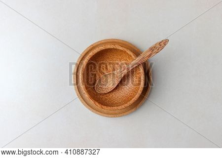 Wooden Utensils On The Kitchen Table. Round Wooden Plates, A Wooden Spoon. The Concept Of Serving, C