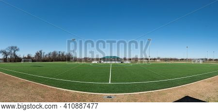 Wide Angle Panoramic View Of A Soccer Pitch From The Sideline On A Sunny Day.