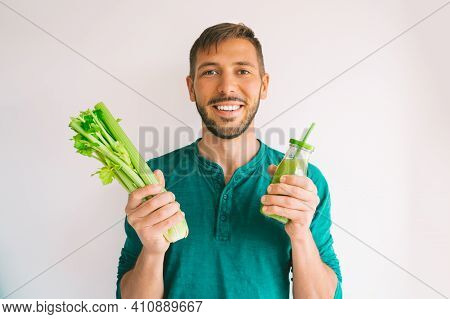 Healthy Detox Vegan Diet. Young Attractive Smiling Man Green Organic Celery And Fresh Homemade Celer