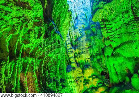 Guilin, China - May 11, 2010: Ludi Lu Or Reed Flute Cave. Blue And Green Lighted Section Of Grotto W