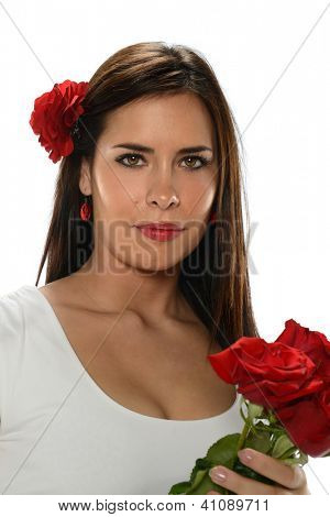 Young Hispanic Woman with red roses and wearing a white dress