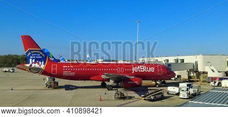Orlando, Florida, U.s - February 22, 2021 - A Red Jetblue Plane To Salute The Fire Department Of The