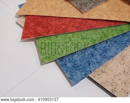 Linoleum. Multi-colored Samples Of Fanned Floor Coverings. Floor Covering For Home And Office.