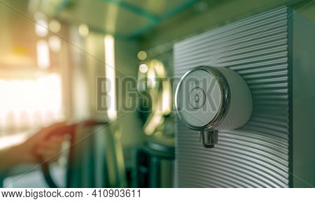 Water Purifier In Apartment Kitchen On Blurred Background Of Woman Hand Holding Handle Of Modern Ele
