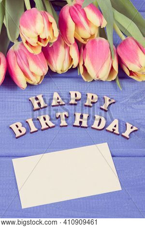 Inscription Happy Birthday And Fresh Tulips On Purple Boards. Surprise For Birthday Occasion. Copy S