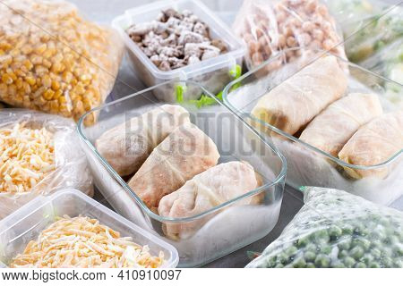 Frozen Semi-finished Products In Containers And Bags On Table