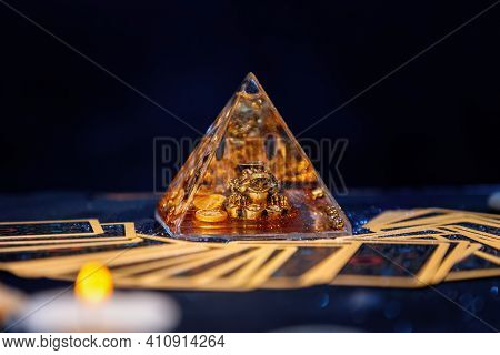 A Glass Pyramid With A Golden Frog. Tarot Cards Are Scattered On The Table. Close-up. Copy Space. Th