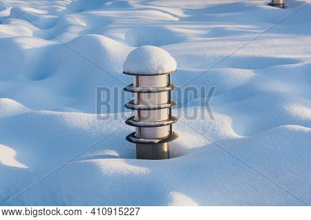 Ground Lamp In The Park, In A Snowdrift In Winter. Modern Outdoor Lighting Technology