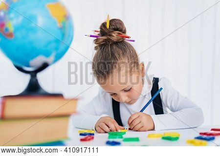 Back To School. Happy Smiling Pupil At The Desk. Child In The Class Room With Pencils, Books. Kid Gi