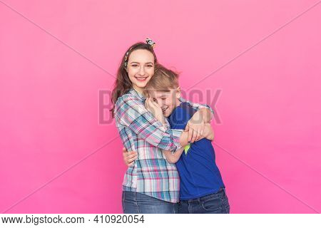 Family Portrait Sister And Teenager Brother On Pink Background