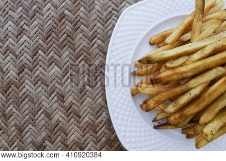 Crispy Crunchy French Fries Heap. Potato Finger Chips With Seasoning Masala. Very Tasty Popular Teat