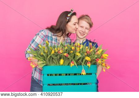 Family Portrait Sister And Teenager Brother With Tulips On Pink Background