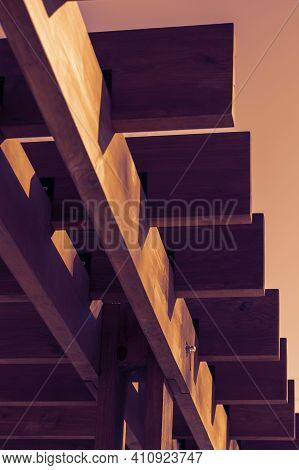Abstract Geometric Composition Of Wooden Boards On The Background Of The Sky. Fragment Of An Archite