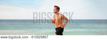 Fitness athlete man running on beach banner. Runner doing outdoor cardio endurance exercise training without t-shirt in hot summer weather. Panoramic .