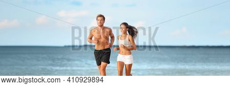 Runners athletes couple running working out exercising cardio outdoor on summer beach doing hiit interval training with friends. Panoramic banner.