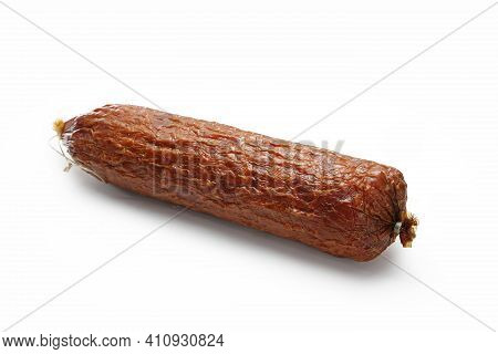 Traditional Dry Smoked Sausage Isolated On A White Background. Whole Krakowska Sausage.