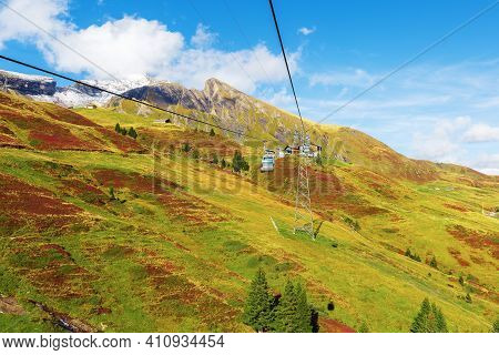 Grindelwald, Switzerland Cable Car Cabins Jungfrau Top Of Europe And Green Swiss Alps Mountains Pano