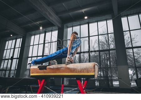 Wellness. Little Male Gymnast Training In Gym, Composed And Active. Caucasian Fit Boy, Athlete In Sp