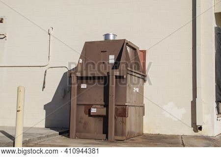 Columbia County, Ga Usa - 01 30 21: Wall Trash Compactor On A Building Copy Space