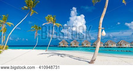 Amazing Panorama At Maldives. Luxury Resort Villas Seascape With Palm Trees, White Sand And Blue Sky