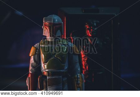 MARCH 1 2021: scene from Star Wars The Empire Strikes Back with bounty hunter Boba Fett and Han Solo frozen in carbonite - vintage Kenner 3.75 inch action figures