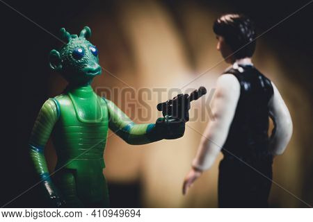 MARCH 1 2021:scene from Star Wars A New Hope with bounty hunter Greedo confronting Han Solo in a Mos Eisley cantina  - vintage Kenner 3.75 inch action figures