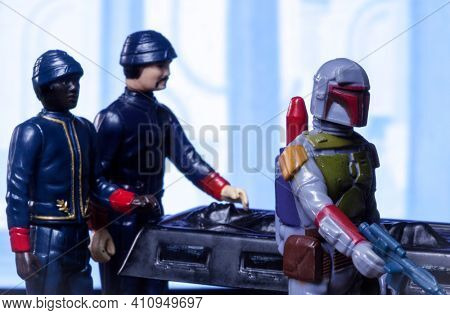 MARCH 1 2021: scene from Star Wars The Empire Strikes Back with bounty hunter Boba Fett on Bespin with Han Solo frozen in carbonite - vintage Kenner 3.75 inch action figures