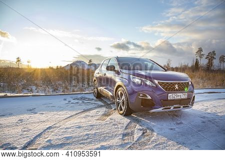Moscow, Russia - March 15, 2020: Blue Suv Peugeot 3008 On The Backdrop Of A Winter Landscape In Suns