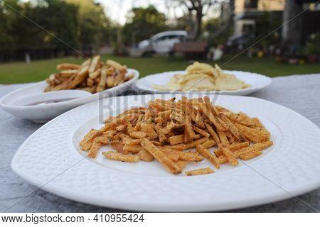 Indian Fasting Upwas Items Eaten During Fesivals As Religious Belief. Snacks Like Potato Chips, Tikh