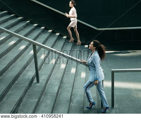Two Business women walking up on stairs