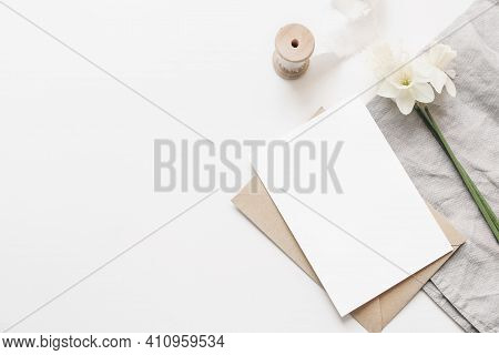 Styled Stock Photo. Spring, Easter Composition With Narcissus, Daffodils Flowers And Linen Napkin Is