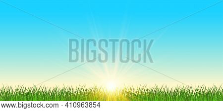 Realistic Sunrise Over A Field Of Grass. Natural Panoramic With Bright Sunlight Background. Sunrise