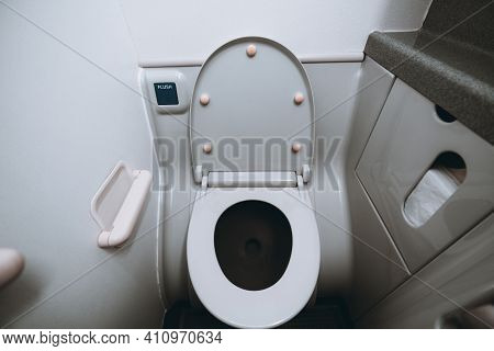 Wide-angle View Of A Part Of The Interior And A Lavatory Bowl With The Lid Open Indoors Of A Small T