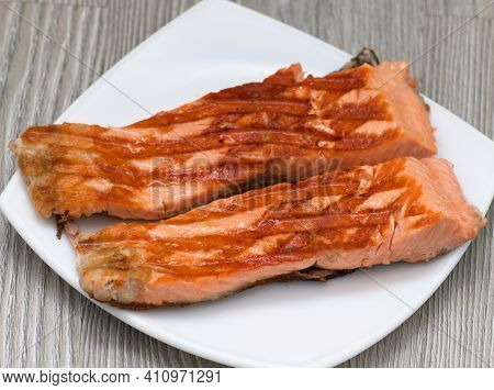 Grilled Trout Steaks Lie On A Plate