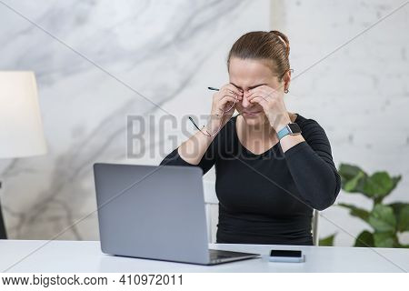 Fatigued Tired Young Woman Is Holding Glasses, Rubbing Her Eyes, Suffering From Eyestrain In Front O