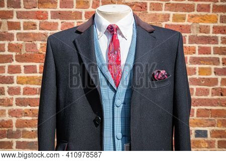 Traditional English Three-piece Suit On Display With Red Brick Background At Camden Market In London