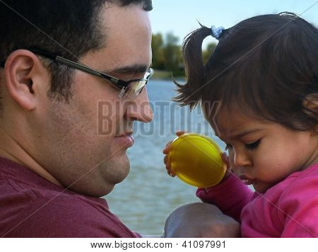 Young father and daughter outdoors.