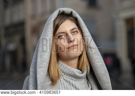 Street Portrait Of A Beautiful Young And Cheerful Woman 25-30 Years Old With Blonde Hair And A Gray