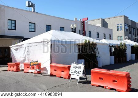 SANTA ANA, CALIFORNIA - 25 FEB 2021: Awnings and tents and closed street outside Festiva Hall during the pandemic.