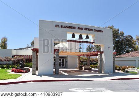 IRIVNE, CALIFORNIA - 21 APRIL 2020: Saint Elizabeth Ann Seton Catholic Church parish is a community annex of Our Lady Queen of Angels Catholic Church in Newport Beach. bells, arch, facade, annex,