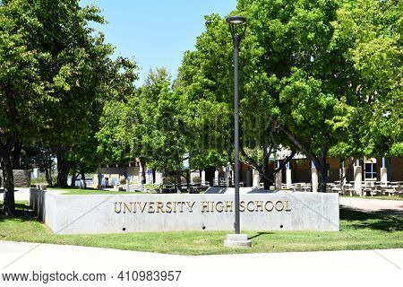 IRVINE, CALIFORNIA - 16 APRIL 2020: Sign and quad at University High School, The first high school in Irvine, is a top rated public school in Orange County.