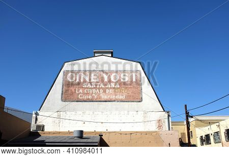 SANTA ANA, CALIFORNIA - 25 FEB 2021: Sign on the Cine Yost building, the oldest theater in Orange County. Translation: City of Gold -  Movies and Variety.
